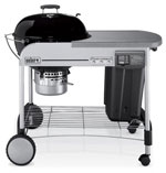 Weber 1481001 Performer® Platinum charcoal grill with black colored porcelain-enameled bowl and lid.