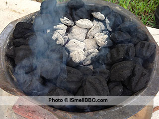 Center section of charcoal is ready when the briquets are mostly covered with gray ash.