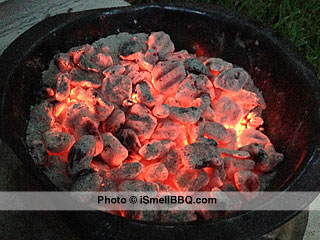 Keep charcoal pan full of enough red hot coals to keep smoker above 180°F.