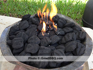 Charcoal started in center only, with lighter fluid.